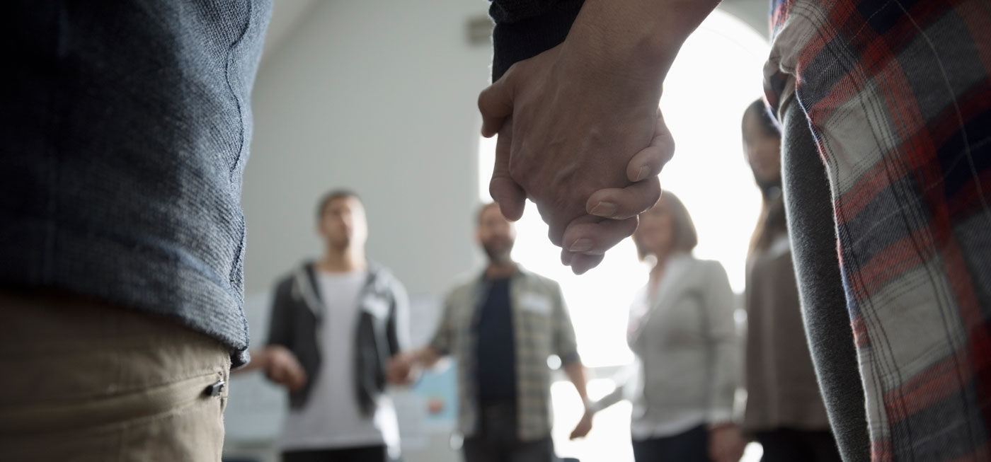 support group holding hands